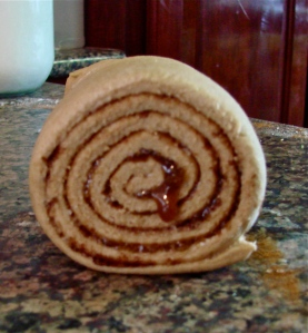 Almost perfectly round roll reminaing with that one delectable little honey dribble