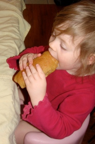 Doodlebug chomping down on her full sized Pig N Blanket
