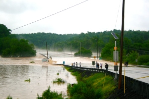 Hwy 100 Bridge from Centerville town square covered with flood waters