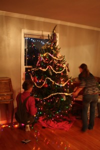 Decorating the tree with popcorn and paperchains