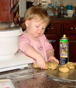 Doodlebug helping to make bread at 2 years old